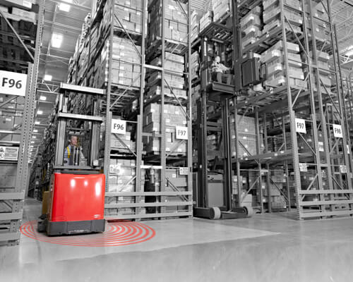 Black and white warehouse graphic with Raymond red forklift showing red rings for geofencing/zoning capabilities.