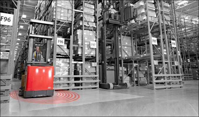 Raymond forklift in a warehouse with red rings on the floor representing the Real-Time Location System.