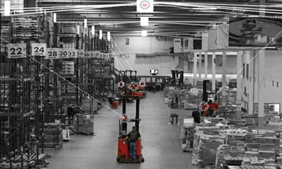 Raymond forklift in a warehouse with lines to forklift to demonstrate where the forklift is using the real-time location system.