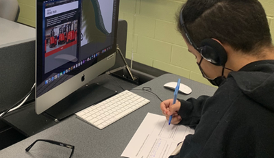 Manufacturing Day, Raymond Corp, Student watching virtual tour on a computer