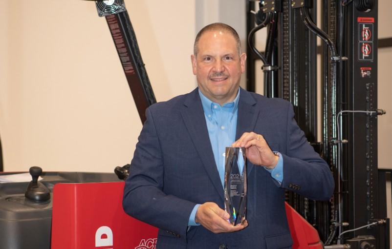 Tony Topenik holds 2021 Manufacturing Leadership Award.