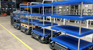 LiftLiner Tugger train with mother-daughter carts in blue.