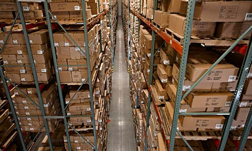 Very Narrow Aisle Warehouse with Raymond Swing-Reach Turret Truck