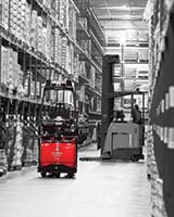 Raymond Courier 3010 Automated Pallet Truck Turning into Aisle in Warehouse