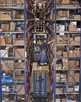 Raymond 5000 Series Orderpicker in warehouse aisle
