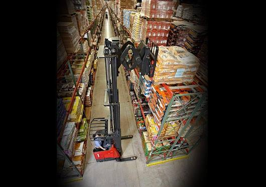 Raymond deep reach forklift in narrow aisle warehouse