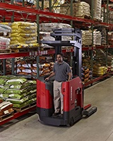 Raymond 7500 Reach-Fork Truck with Universal stance in warehouse