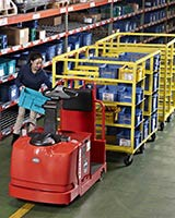 Raymond 8610 Tow Tractor in warehouse