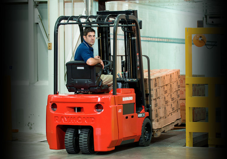 Raymond 4450 Sit Down Counterbalanced Truck with specialized load handling attachments
