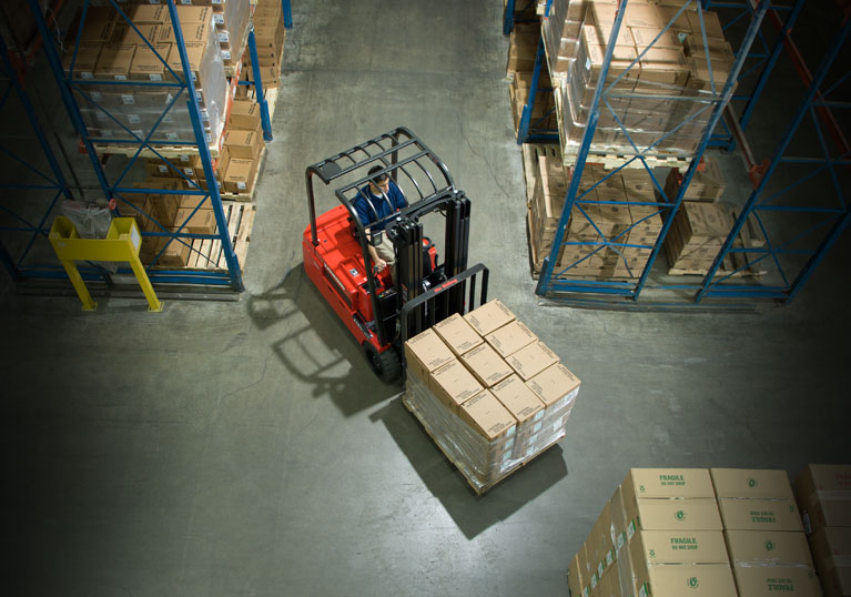 Raymond 4450 Sit Down Counterbalance Lift Truck transporting load