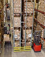 Raymond 5000 Series Orderpicker in warehouse aisle